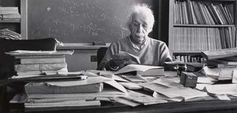 Einstein working at his desk